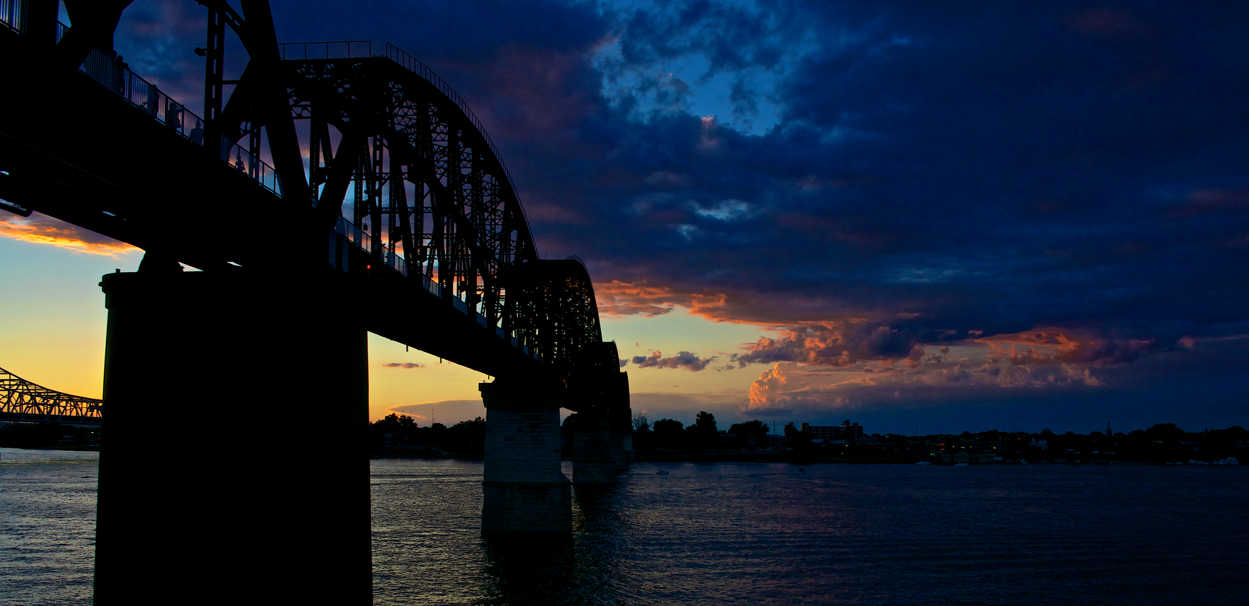 Louisville's Big Four Bridge after a day of thunderstorms and rain.